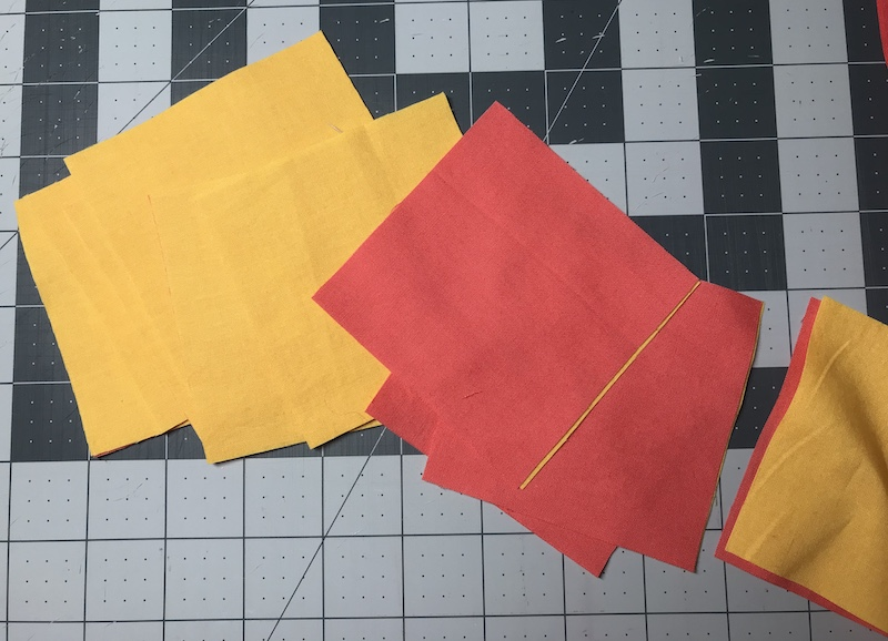 Cutting squares from the strips for nine patch quilt block