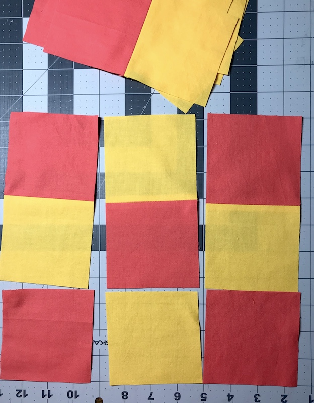 Laying out the blocks for nine patch quilt blocks