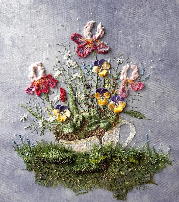 Flowers and johnny jump ups in a tea cup embroidery