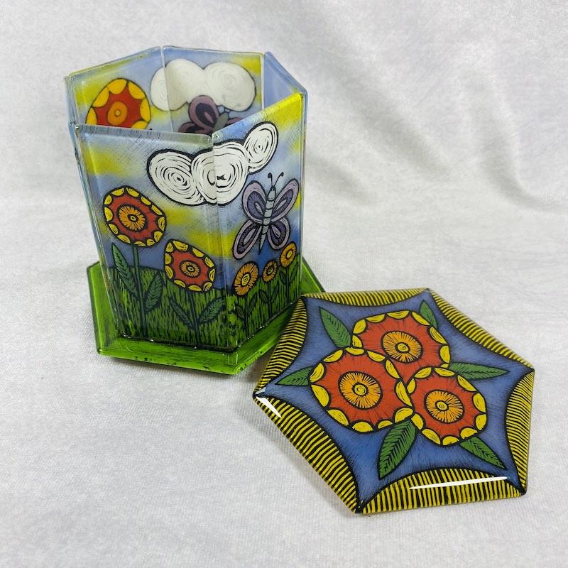Hexagon glass container with milkweed