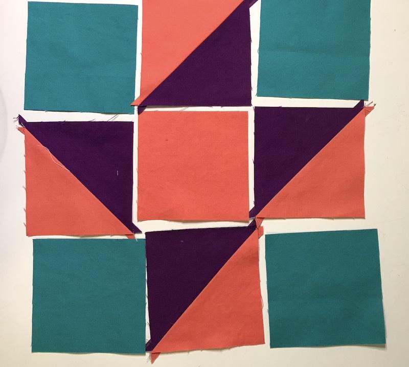 Simplex Star quilt blocks laid out