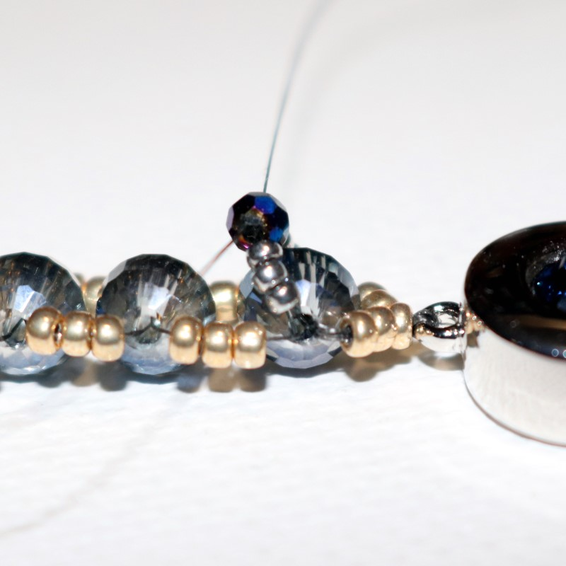 Looking Glass Bracelet pull taut on top of bracelet