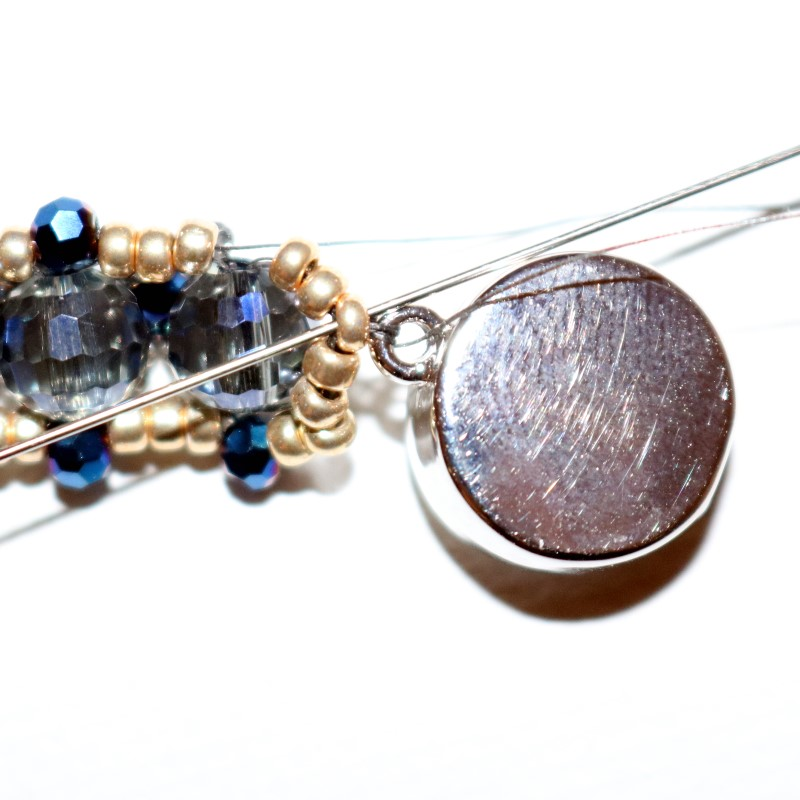Looking Glass Bracelet stitch through clasp and back through 11
